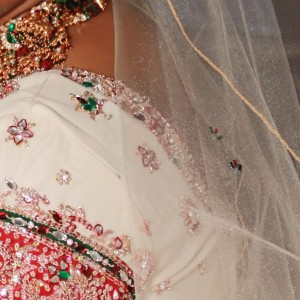 red and green rhinestones embellishing a veil