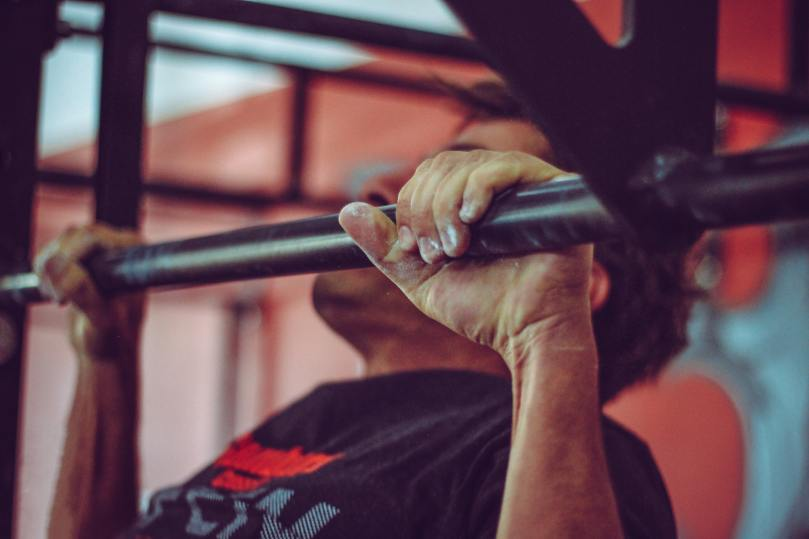 Photo by Victor Freitas from Pexels, someone doing pull-ups during the convict conditioning review.