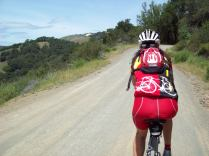 Krissy about to ride away from me climbing Santa Rita Road