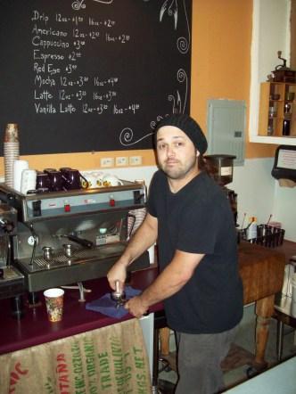 Back at Dark Nectar, Paul makes my decaf Americano.