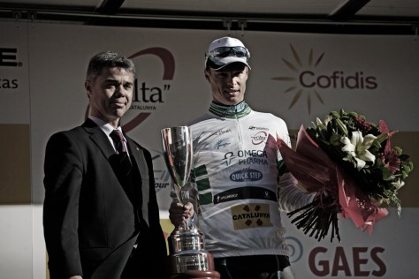 Gianni Meersman of OPQS receives his bouquet for his Stage 1 victory