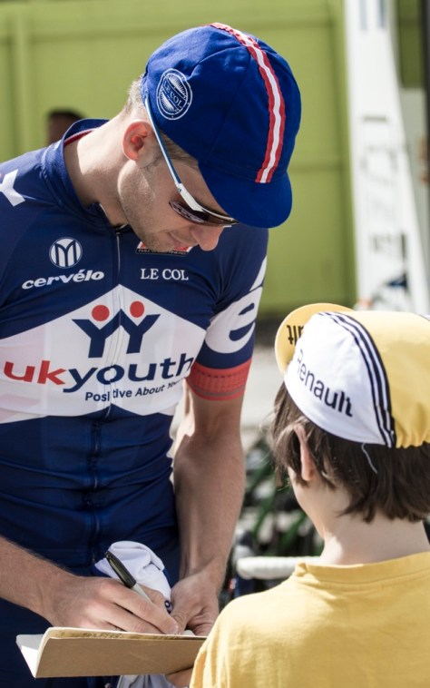 Niklas Gustavsson signs an autograph for a young race fan