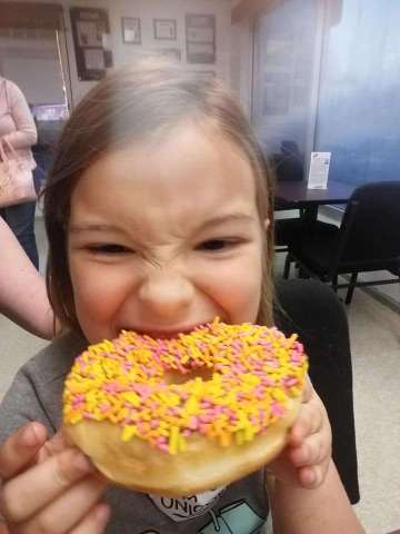 Elena loves the sprinkles and icing donut
