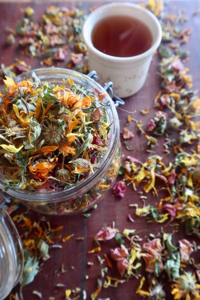 herbal tea calendula rose chamomile mint glass jar wooden board