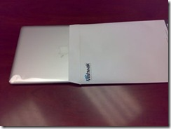 macbook air inside an envelope