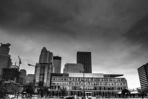 photo of central library in downtown minneapolis. In the background are other buildings.