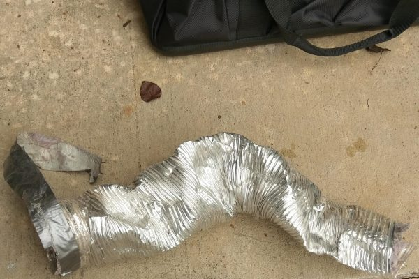 This was the transition line behind the dryer.  This is why you do not use flexible duct behind a dryer.  Crushed!