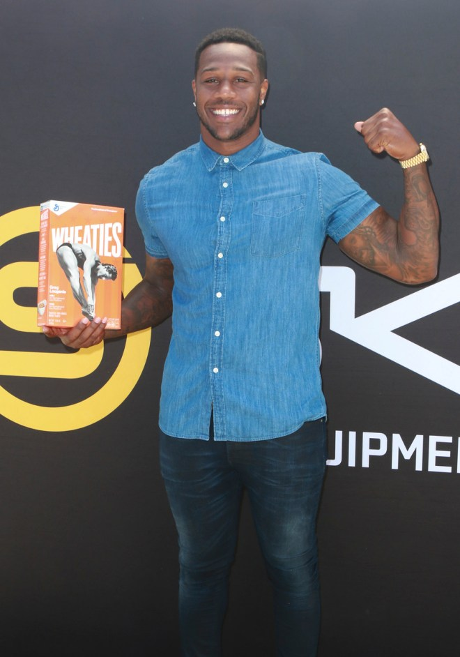 Akeem Ayers poses with Wheaties box at The Starving Artists Project in Los Angeles. PHOTO CREDIT: Tasia Wells/The Starving Artists Project