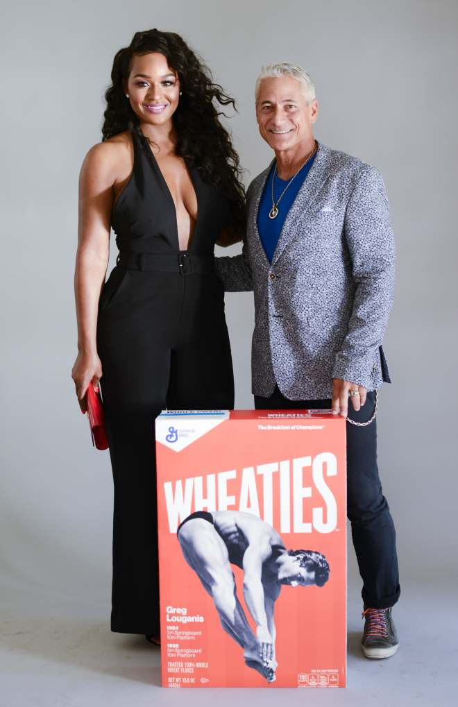 Brandi Maxiell and Greg Louganis pose for portraits with giant Wheaties box. PHOTO CREDIT: Michael Bezjian/The Starving Artists Project