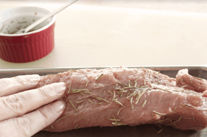 Rub in the rosemary wet rub into the pork tenderloin