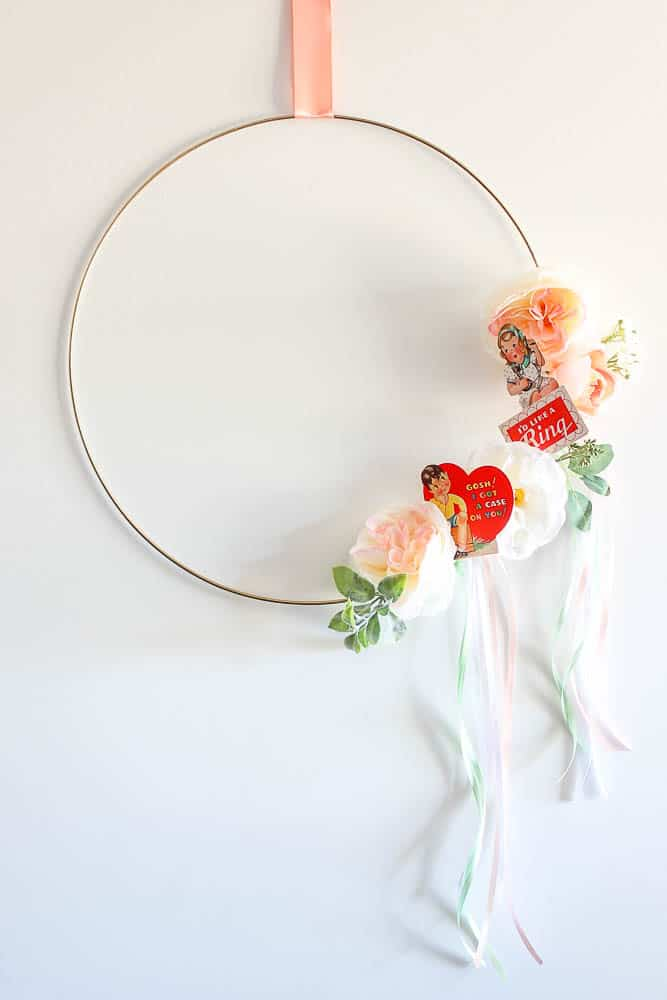 Round wreath decorated with vintage valentine's day cards