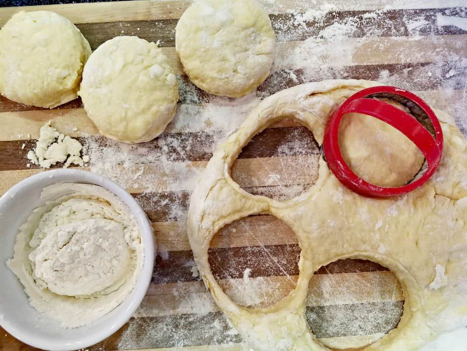 Cutting buttermilk biscuits out of dough