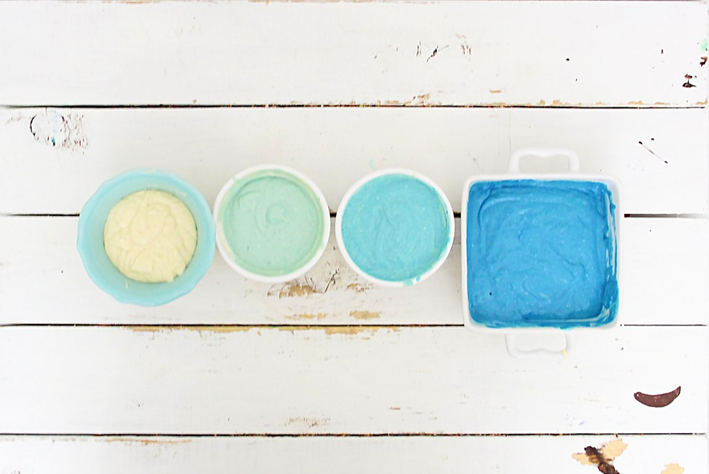Pancake batter in 4 different bowls with different shades of blue.