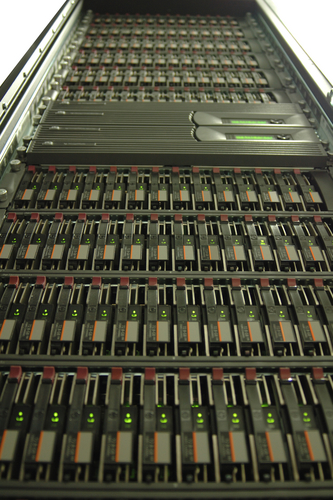 Photo of a tower of disk drives in racks