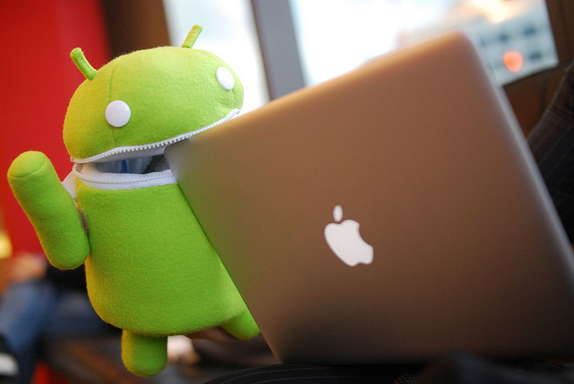 android eating apple macbook