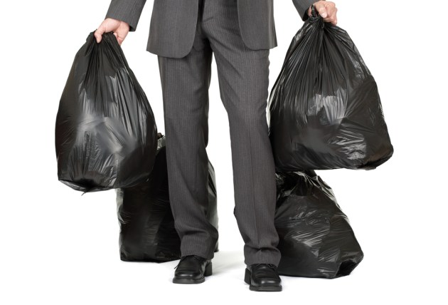 Man with four trashbags