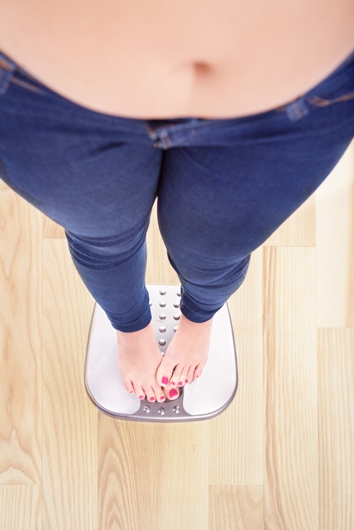 examiner-size-woman-scale-fat