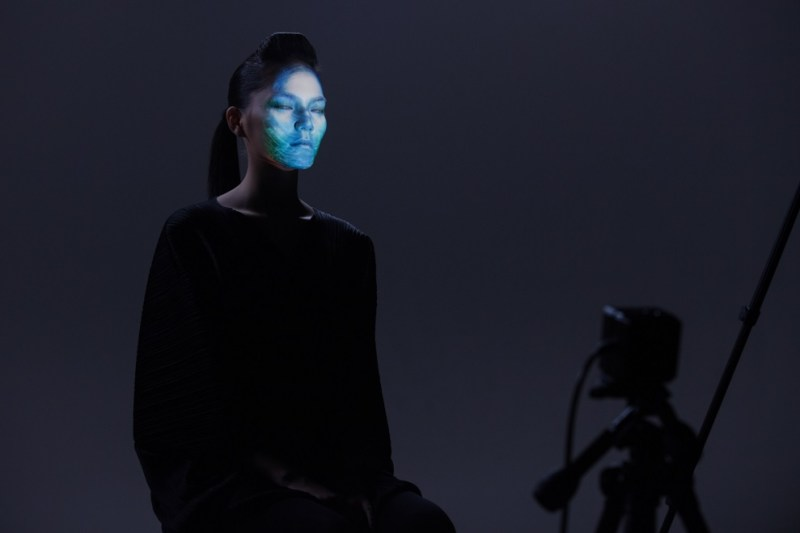 Intel projects colors on to a model's face in real-time.