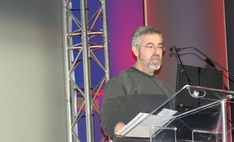 Warren Spector gives a talk at last fall's MIGS event in Montreal.