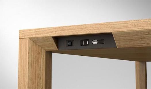 Kamarq power source and USB sockets on table