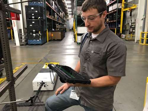 Matt Younger, a Project Engineer at Polaris, shows how the delivery bots work.
