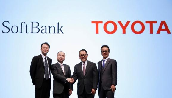 Toyota President Akio Toyoda and Executive Vice President Shigeki Tomoyama pose for a photograph with SoftBank Chairman and CEO Masayoshi Son and SoftBank Representative Director and CTO Junichi Miyakawa during joint news conference in Tokyo.