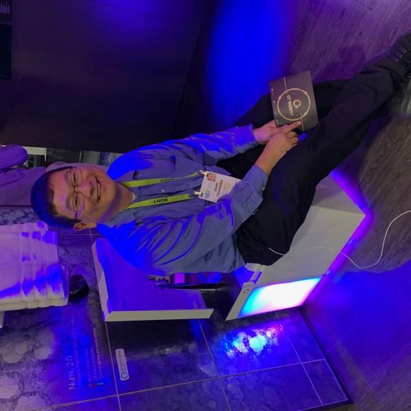 Dean Takahashi sitting on the Kohler Numi 2.0 smart toilet.