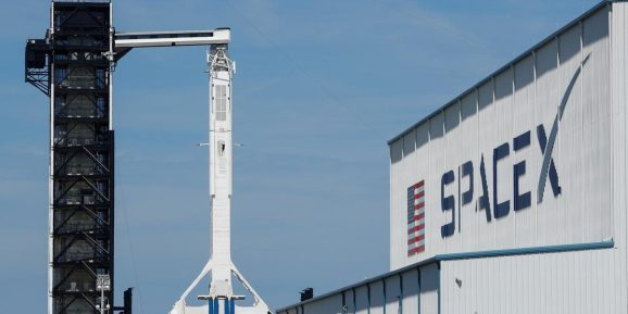 FILE PHOTO: A SpaceX Falcon 9 carrying the Crew Dragon spacecraft sits on launch pad 39A prior to the uncrewed test flight to the International Space Station. March 1, 2019.