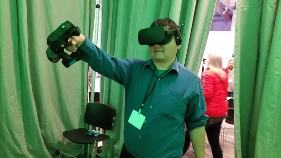 Dean Takahashi demos the Tactical Haptics Reactive Grip controller.