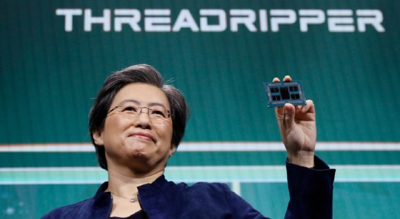 AMD's Lisa Su shows off the latest 64-core Threadripper processor.