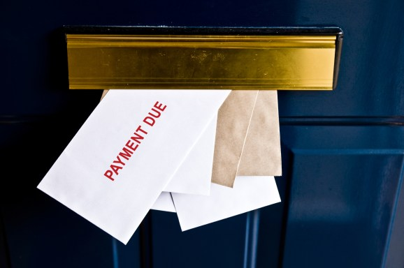 Letters in letterbox saying payment due