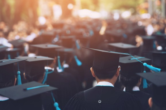 University Students Wearing Mortarboards During Event