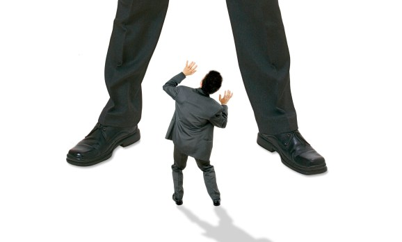 small person being threatened by much larger person