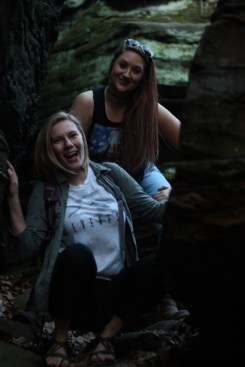 Haley and Ally smile in between the rocks