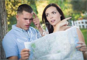 Lost-Confused-Couple-Looking-Map-2777839