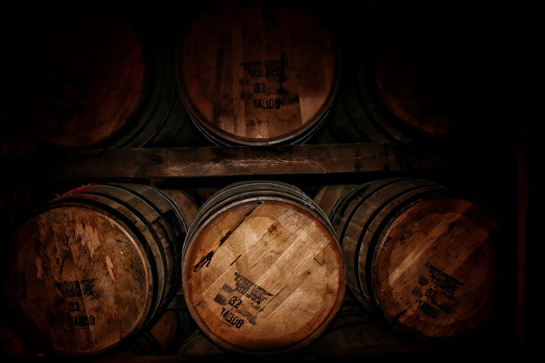 Barrels Of Bourbon Aging On Racks At Makers Mark