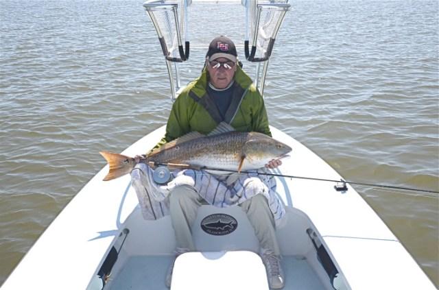Coach Bobby Knight Hoists a Heavy Fly Caught Redfish