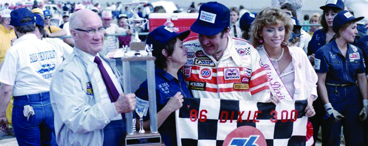 Bill and Cathy Venturini celebrating in victory lane at Atlanta Motor Speedway