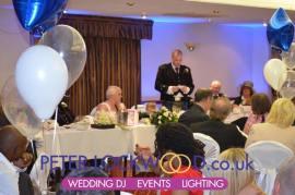 Wedding speeches with blue uplighting