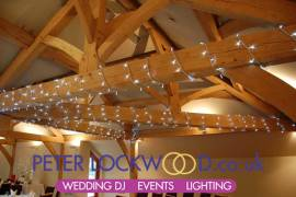 String-lights-around-the-oak-beams-in-the-white-hart