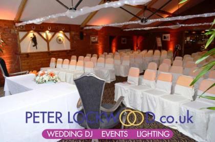 orange-wedding-mood--lighting-in-the-horseshoe-suite-at-the-bolholt-bury
