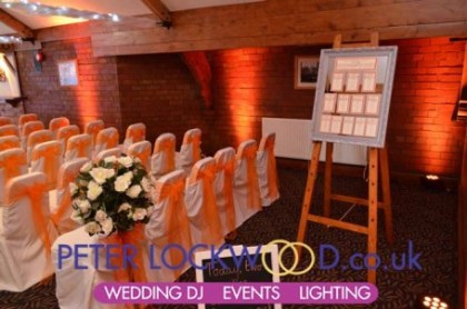 wedding-orange-lighting-in-the-horseshoe-suite-at-the-bolholt,-bury