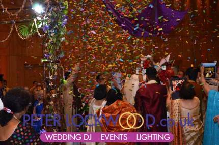 confetti-cannons-fired-as-the-bride-and-groom-exchange-garlands-in-the-hilton-manchester