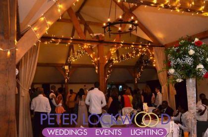 sandhole-oak-barn-wedding-lighting-around-the-oak-beams
