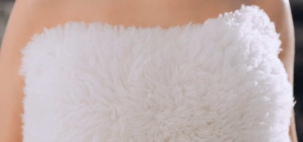 Woman with faux fur white with nothing else standing for the cruelty-free movment