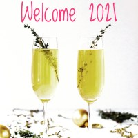 Image with two glasses filled with lemon juice and herbs and a phrase saying Welcome 2021