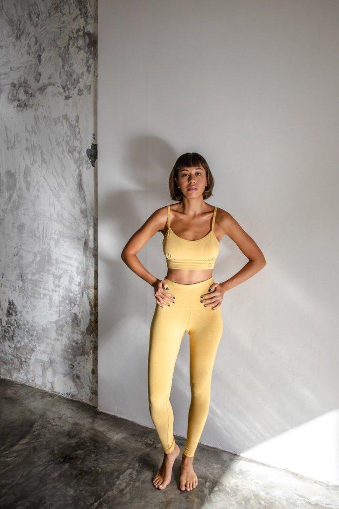 Girl wearing Indigo brand with anada leggings in a yellow colour