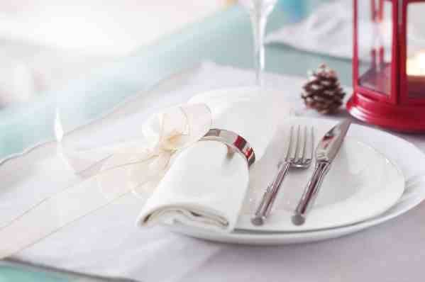 plate-with-cutlery-well-decorated-with-napkin-tied-with-golden-bow