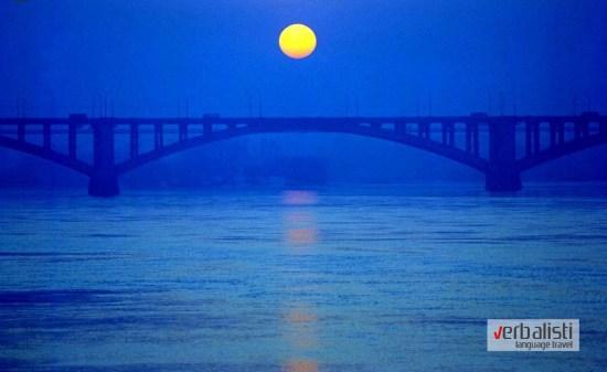 The sun sets above Yenisei river in the Siberian city of Krasnoyarsk
