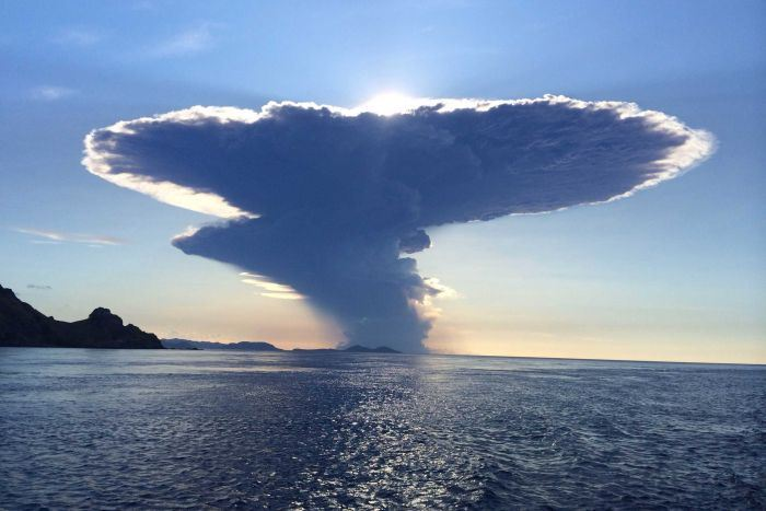 Menacing 12-mile-high ash cloud looms over Indonesia's 'Mountain of Spirits' after volcano erupts